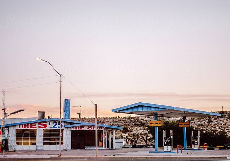 A gas station in the desert by Joseph West Photography for Stocksy United