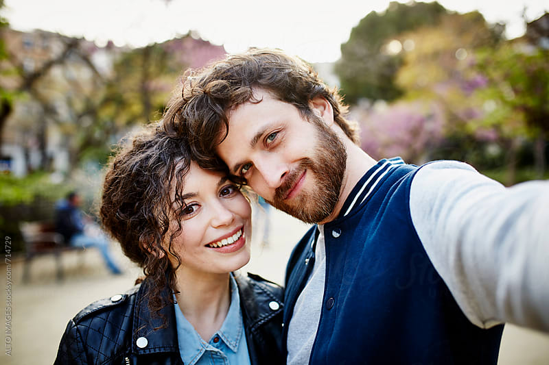 Smiling Young Couple In Park by ALTO IMAGES for Stocksy United