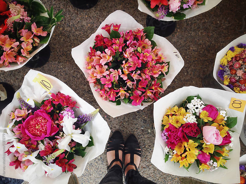 Girl's Feet Surrounded By Bouquets by B. Harvey for Stocksy United