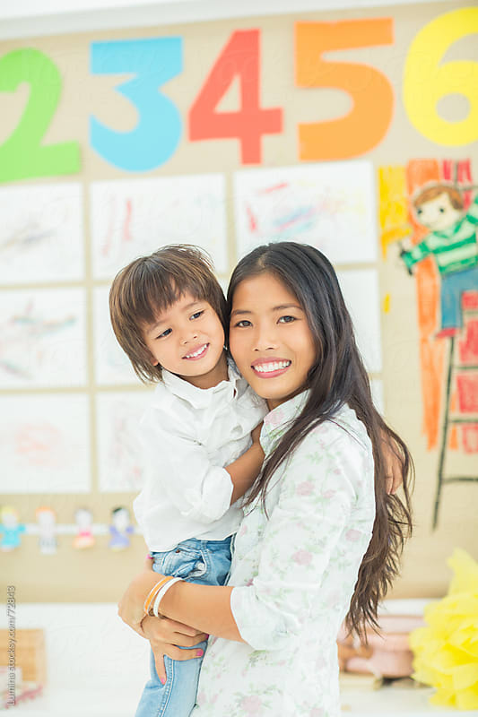 Kindergarten Teacher and Her Cute Student by Lumina for Stocksy United