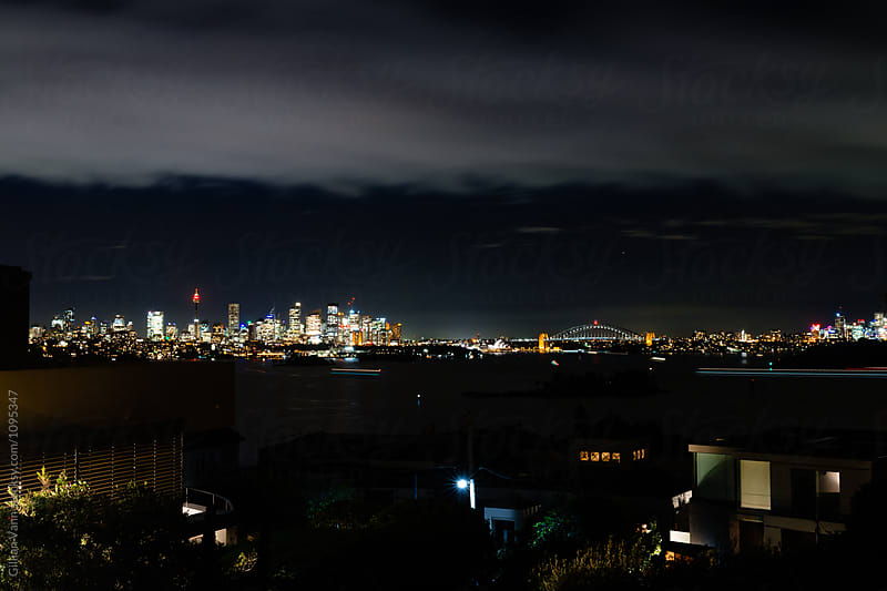 sydney at night from the Eastern Suburbs by Gillian Vann for Stocksy United