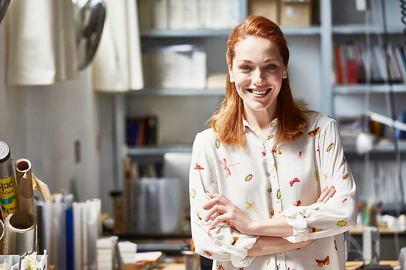 Beautiful Businesswoman Standing At Desk by ALTO IMAGES for Stocksy United