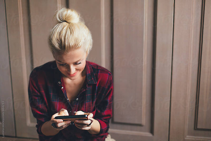 Happy Blonde Woman Texting  by Lumina for Stocksy United