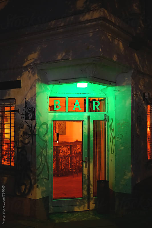Illuminated bar entrance at night by Marcel for Stocksy United