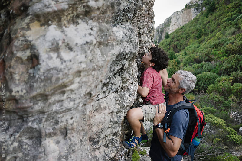 Father and Son Rock Climbing by Bruce and Rebecca Meissner for Stocksy United