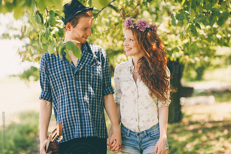 Couple Having a Walk in an Orchard by Lumina for Stocksy United