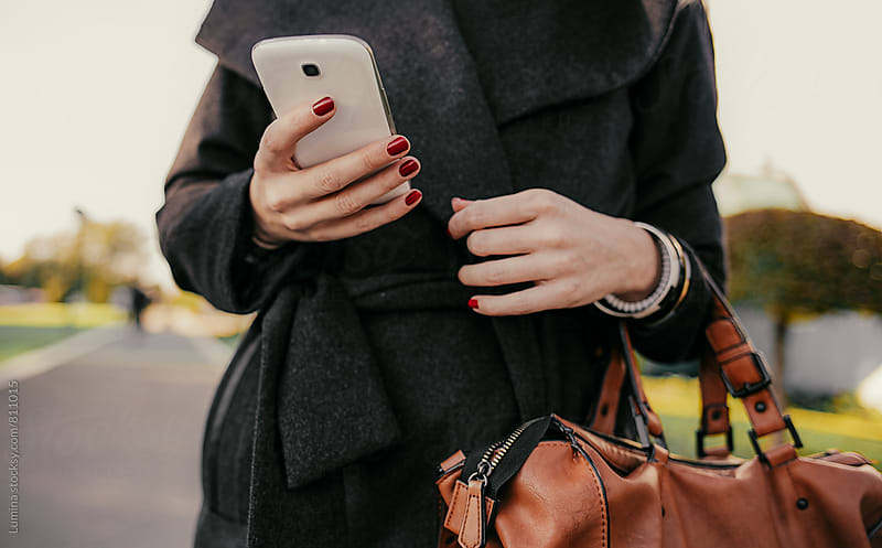 Hands of a Woman With a Mobile Phone by Lumina for Stocksy United