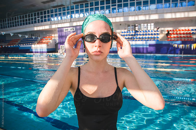 Portrait of young woman wearing goggles and green cap by Danil Nevsky for Stocksy United