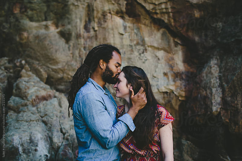 Cute couple at the coast by luke + mallory leasure for Stocksy United