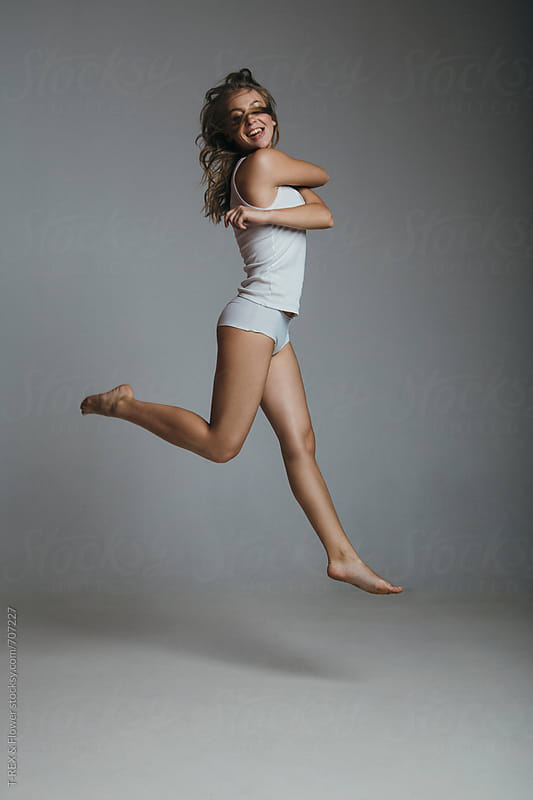 Model test of girl jumping in the studio by Danil Nevsky for Stocksy United
