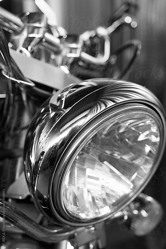 Close-up of motorbike headlight by T-REX & Flower for Stocksy United