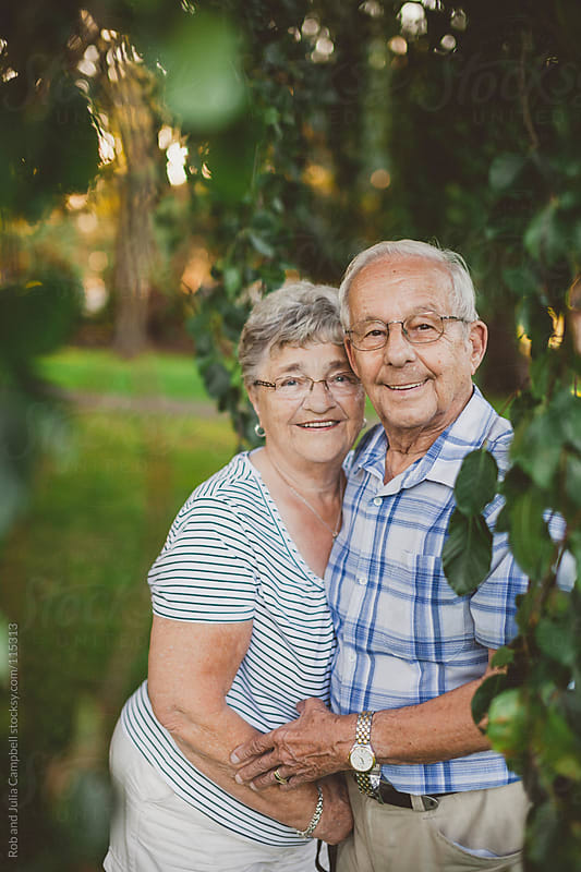 Cute elderly couple smiling together by Rob and Julia Campbell for Stocksy United