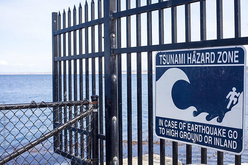 Sign warning of a Tsunami in  the event of a big earthquake by Carolyn Lagattuta for Stocksy United