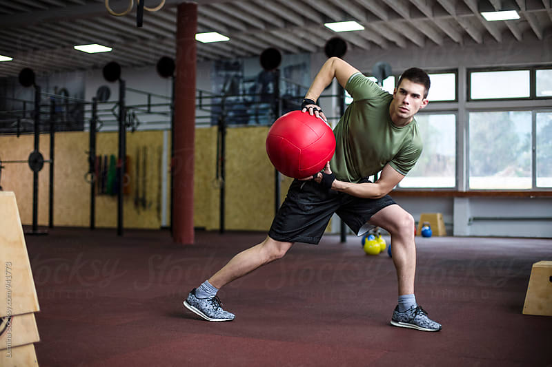 Man Doing Exercise with Medicine Ball by Lumina for Stocksy United
