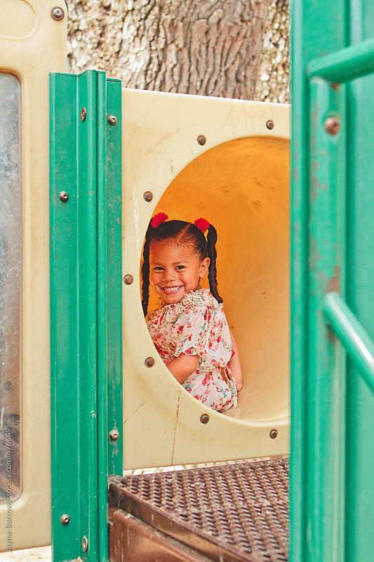 Young Latina Girl on Playground by Jayme Burrows for Stocksy United