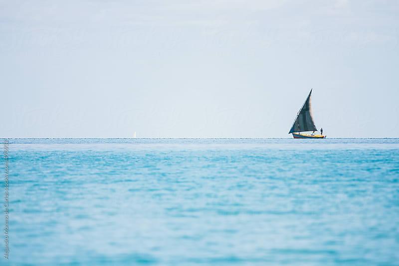 Traditional sailboat on tropical blue sea. Vilanculos, Mozambique by Alejandro Moreno de Carlos for Stocksy United