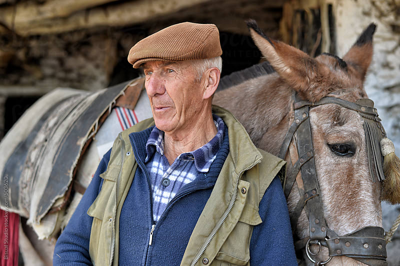 Andalusian farmer with mule by Bisual Studio for Stocksy United