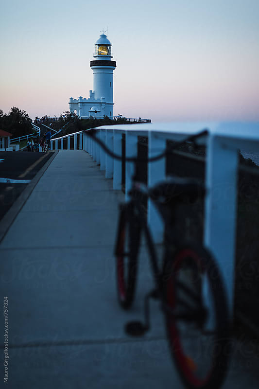 Lighthouse at sunset by Mauro Grigollo for Stocksy United