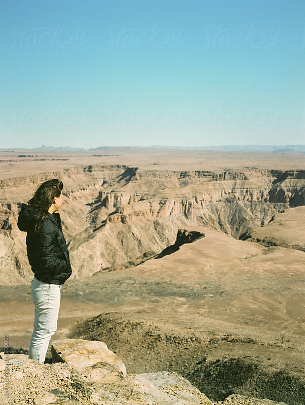 Woman taking in the view of the Fish River Canyon, Namibia by Micky Wiswedel for Stocksy United