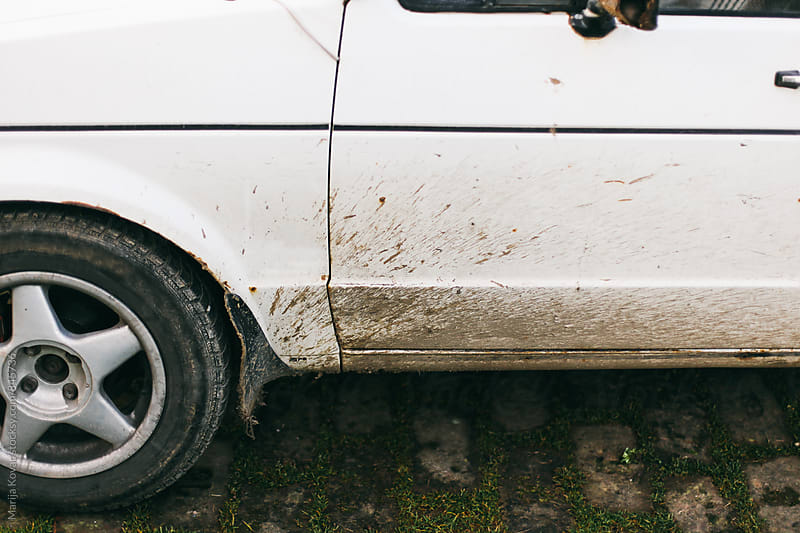 Dirty car  by Marija Kovac for Stocksy United