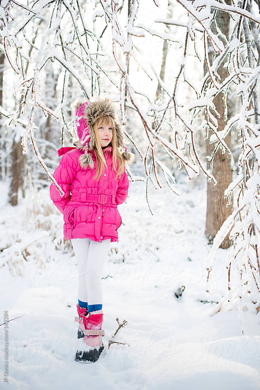 Little Girl Walking in Frozen Winter Woods With Ice and Snow by JP Danko for Stocksy United