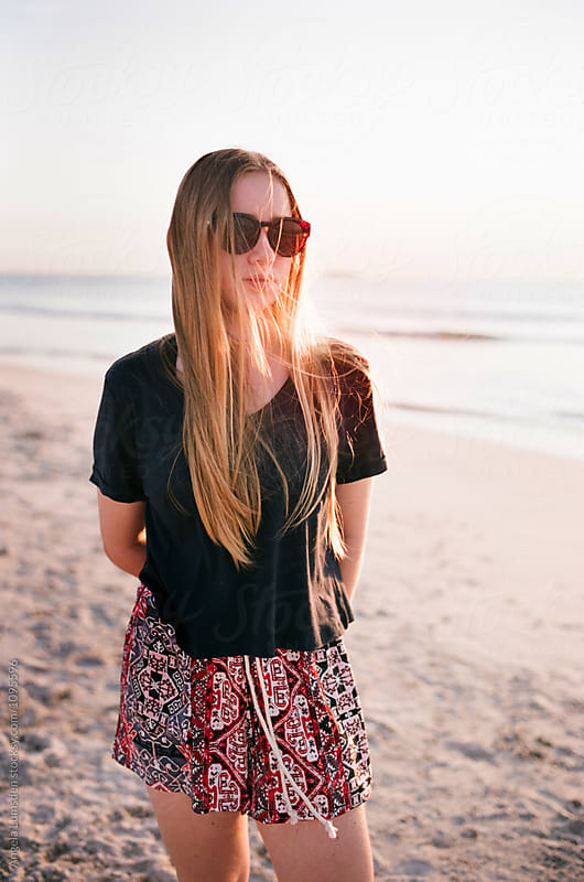 Teenage girl at the beach by Angela Lumsden for Stocksy United
