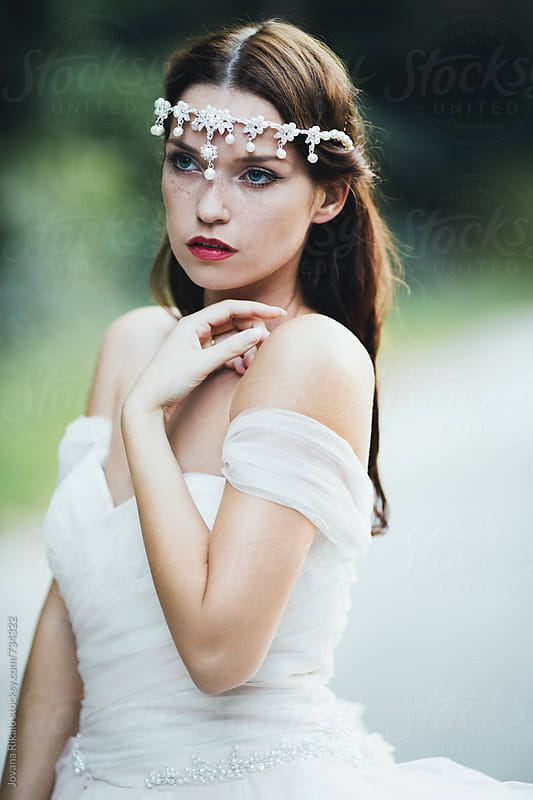 Portrait of a beautiful bride in a romantic wedding dress by Jovana Rikalo for Stocksy United