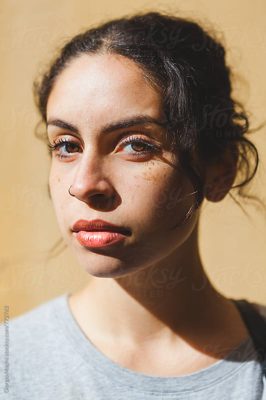 Closeup Portrait of a Beautiful Mixed Race Girl under the Sun by Giorgio Magini for Stocksy United