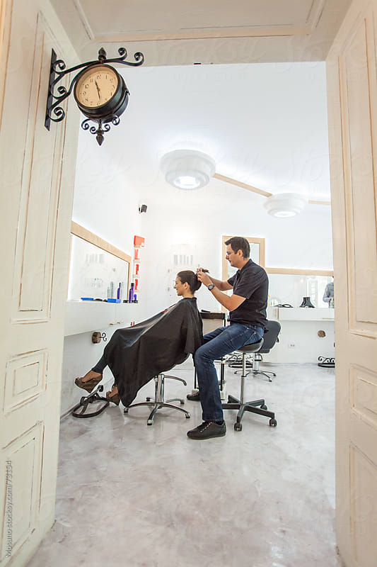Hairdresser and Client in a Hair Salon by Mosuno for Stocksy United