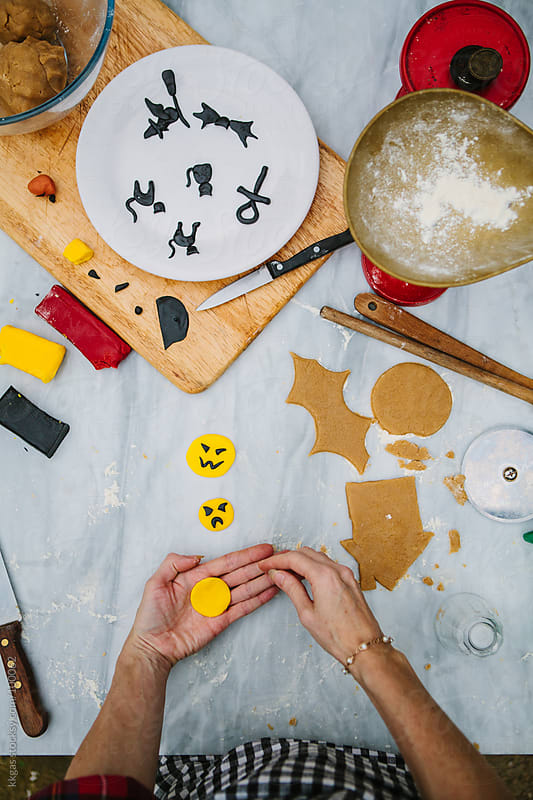 Making decorations for Halloween cookies by kkgas for Stocksy United