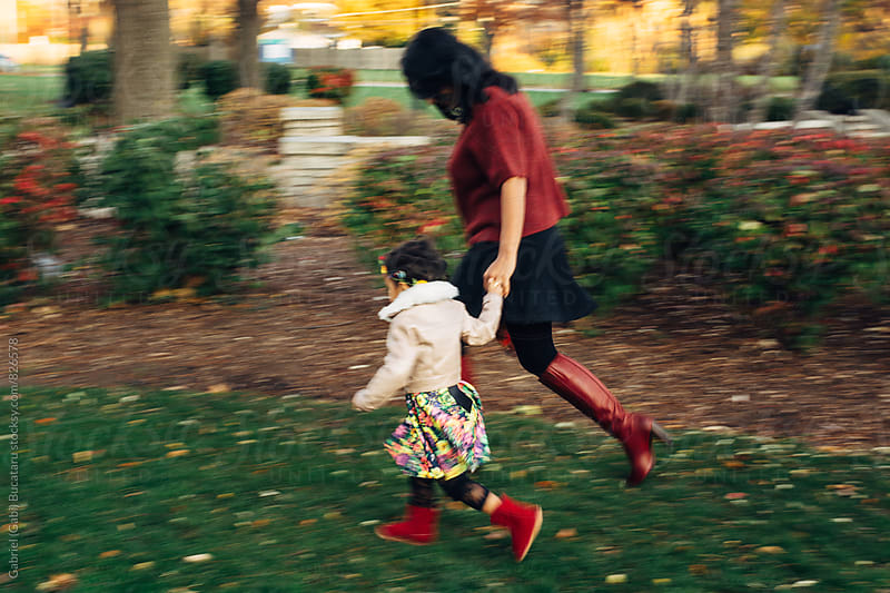 Mother and daughter running in park by Gabriel (Gabi) Bucataru for Stocksy United