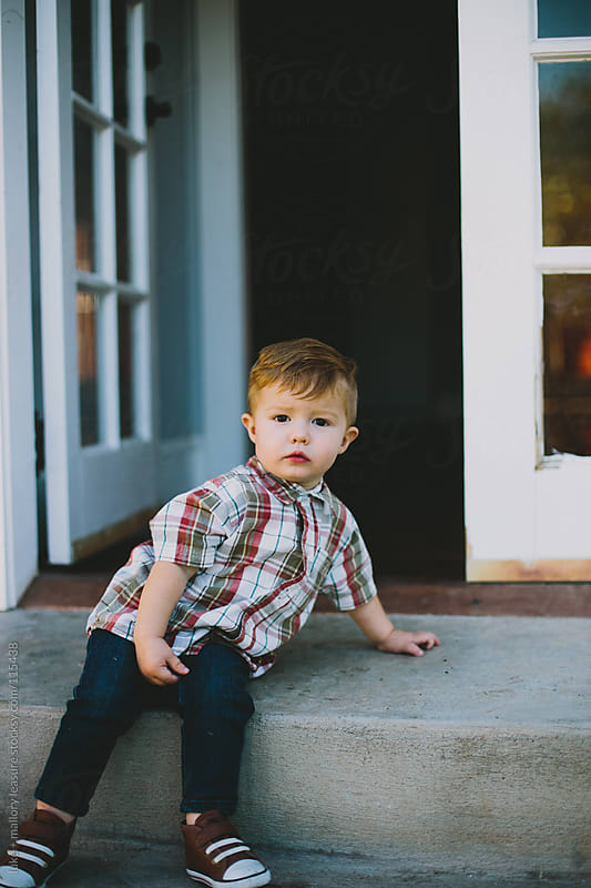 Toddler Sitting on Step Outside House by luke + mallory leasure for Stocksy United