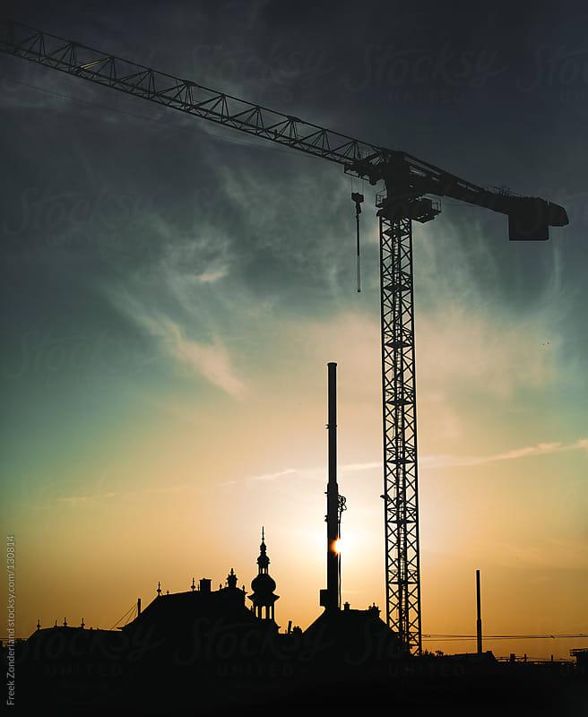 Sunset Crane by Freek Zonderland for Stocksy United