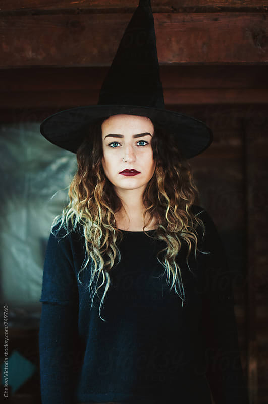 A young woman dressed as a witch by Chelsea Victoria for Stocksy United