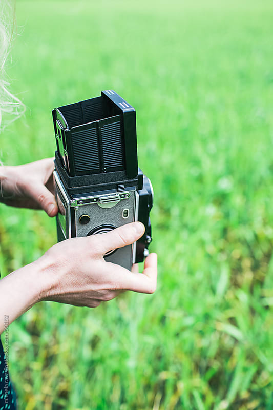 Female hands holding vintage film camera by michela ravasio for Stocksy United