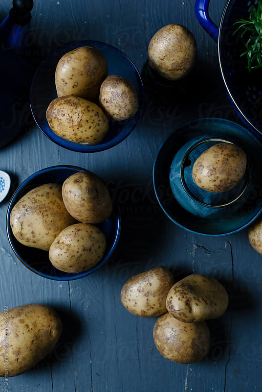 Crop of potatoes seen from overhead. by Darren Muir for Stocksy United