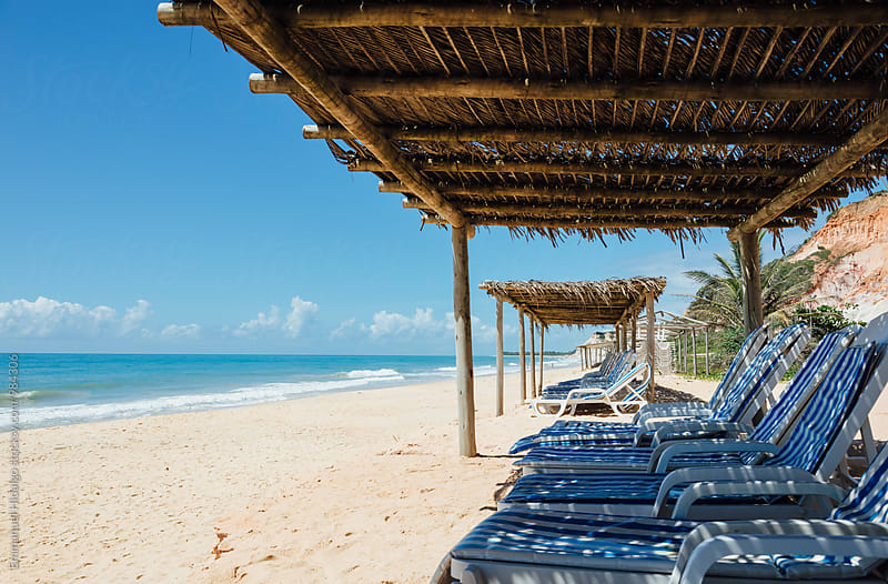 Empty beach chairs line this beautiful beach in Bahia, Brazil by Emmanuel Hidalgo for Stocksy United