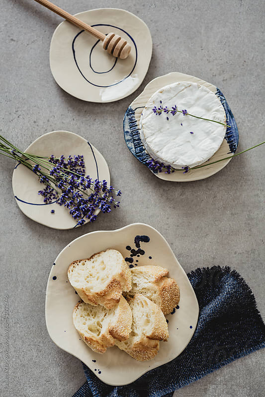 Artistic plate with camembert and lavender by Tatjana Zlatkovic for Stocksy United