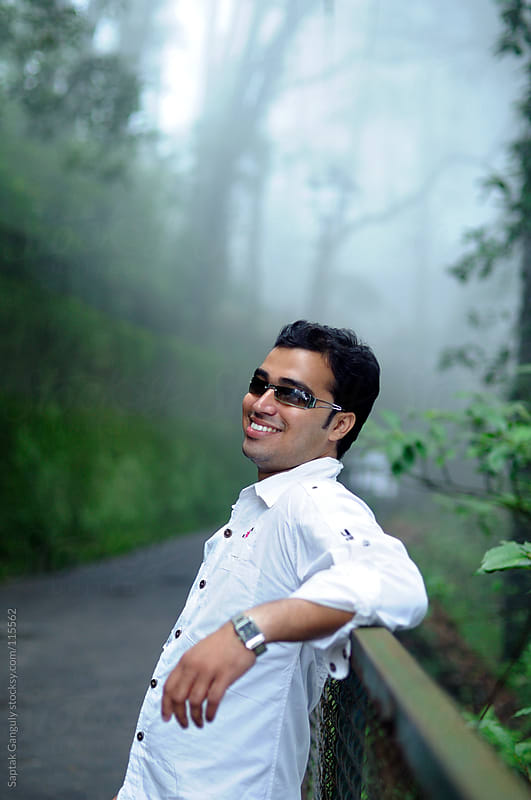 Outdoor portrait of young man laughing by Saptak Ganguly for Stocksy United