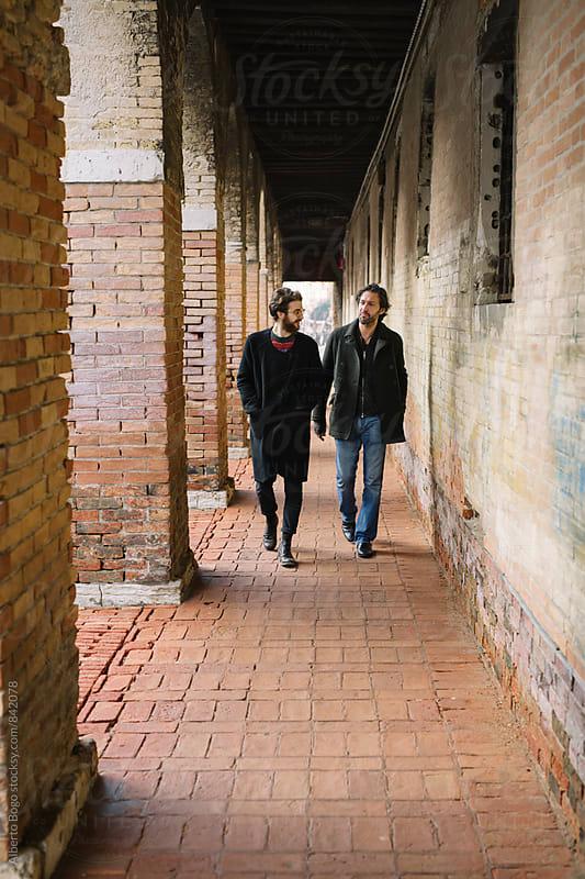 Best Friends walking on the Street by Alberto Bogo for Stocksy United
