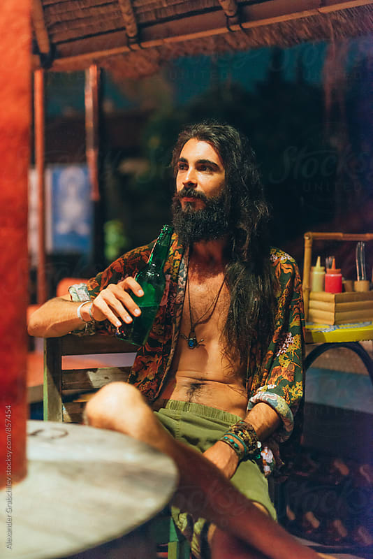 Man Drinking Beer at the Bar by Alexander Grabchilev for Stocksy United