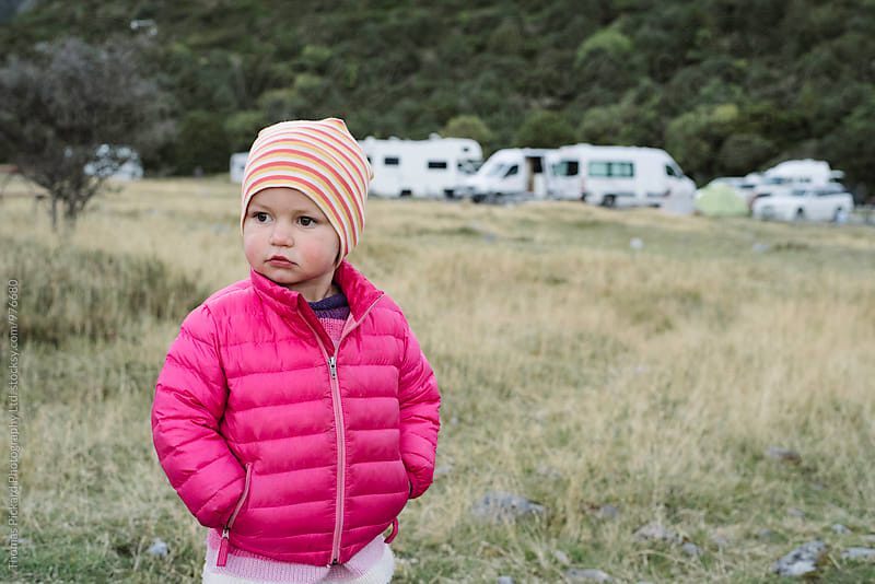 Toddler girl in down jacket while camping, Aoraki / Mt Cook National Park, New Zealand. by Thomas Pickard Photography Ltd. for Stocksy United