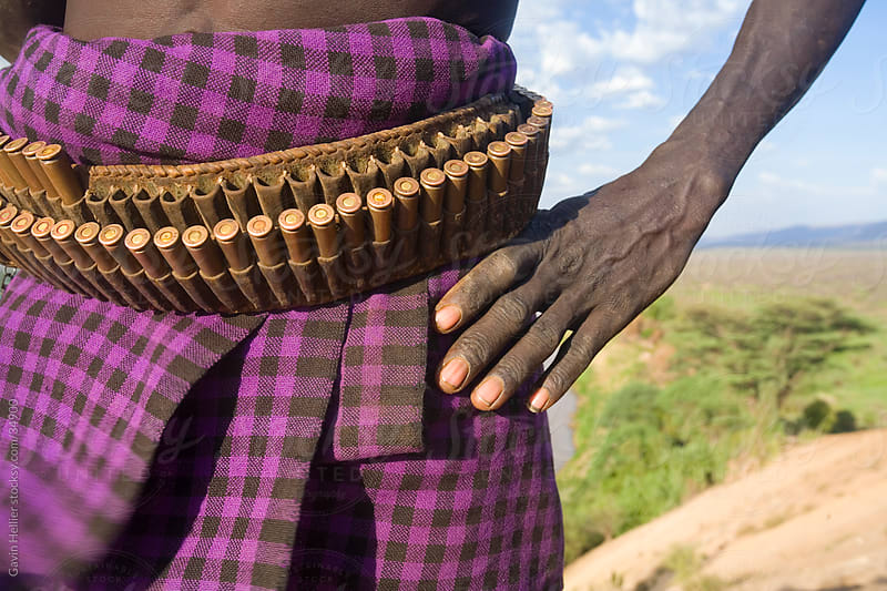 Karo Tribesman wearing a belt of bullets,  Lower Omo Valley, Ethiopia, Africa. by Gavin Hellier for Stocksy United