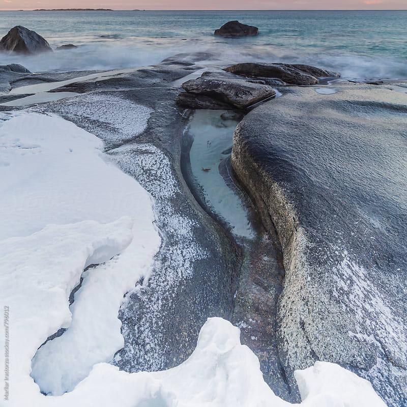 Beautiful rocky sea shore with snow by Marilar Irastorza for Stocksy United