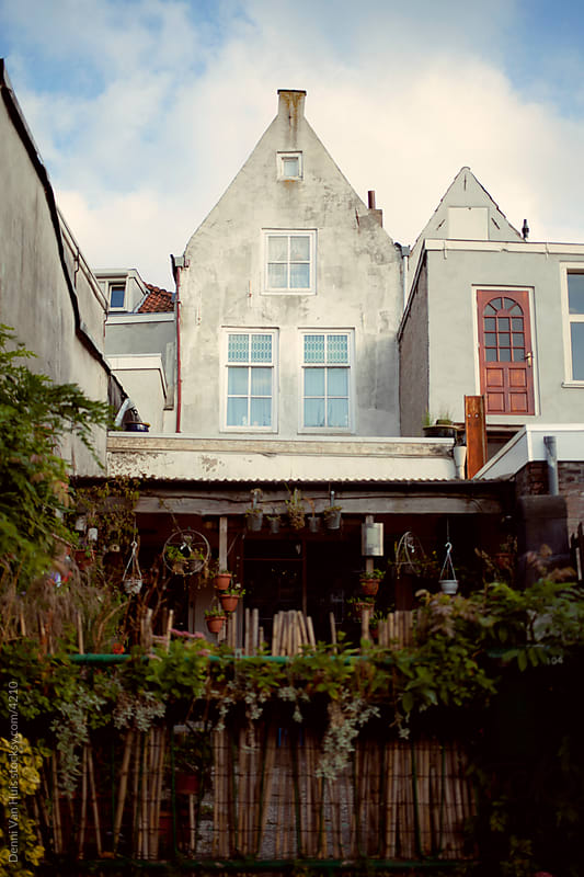 Old traditional Dutch house with a big front garden. by Denni Van Huis for Stocksy United