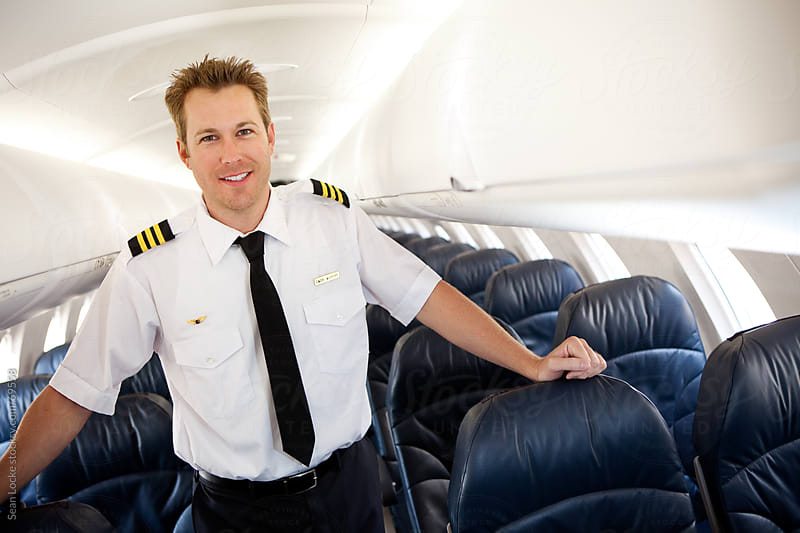 Airplane: First Officer Standing In Aircraft by Sean Locke for Stocksy United