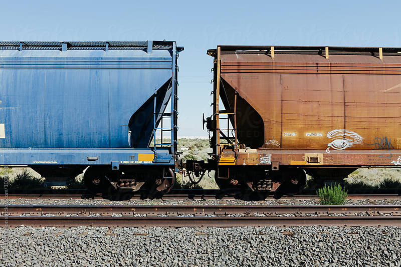 Train cars in desert, near Wendover, UT by Paul Edmondson for Stocksy United