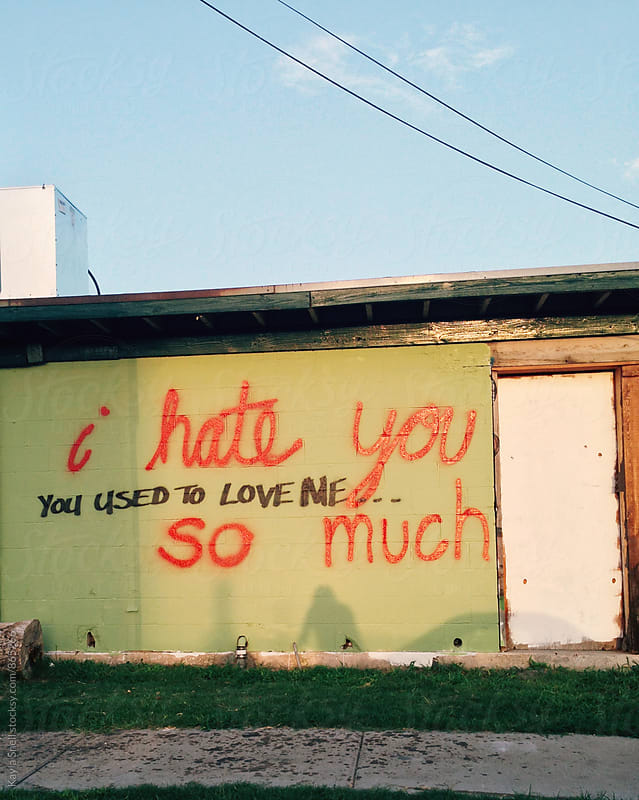 Hate & Love Graffiti wall by Kayla Snell for Stocksy United
