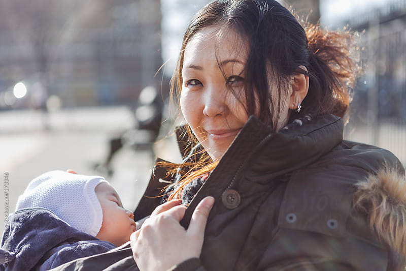 Mother with Baby Child in Park on a Sunny Day in New York by Joselito Briones for Stocksy United