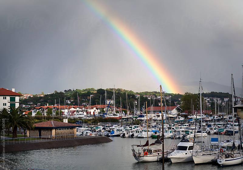 Rainbow on Hendaye marina by Ivan Bastien for Stocksy United